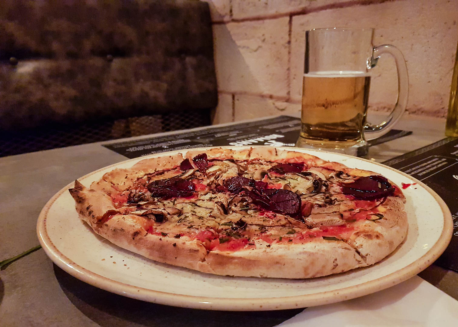 Pizza number 9 with cauliflower cous cous and smoked red beet at the new vegan-friendly restaurant Romans Pizzeria Glasgow.