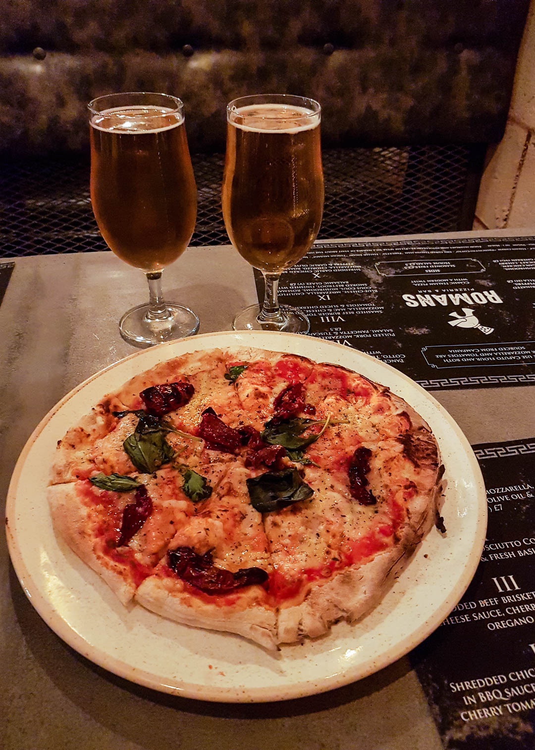 Pizza number 1 with sunblushed tomatoes, vegan mozzarella and fresh basil at the new vegan-friendly restaurant Romans Pizzeria Glasgow.