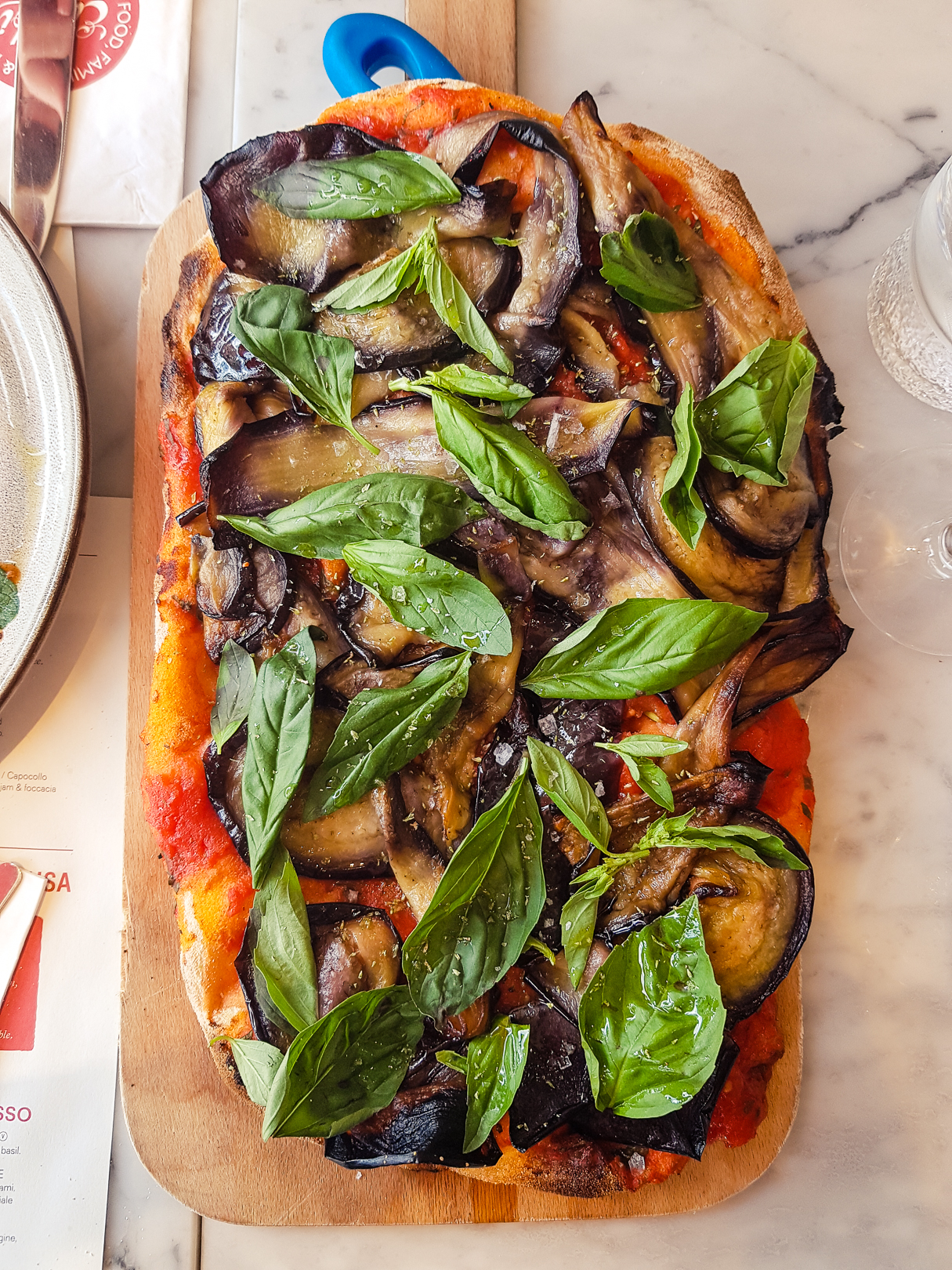 Roman-style pizza with aubergines and basil at Eusebi Deli Glasgow.